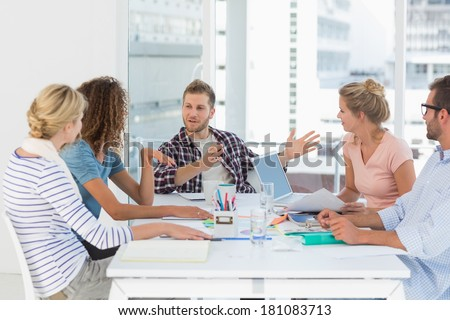Young design team having a meeting together in creative office - stock photo