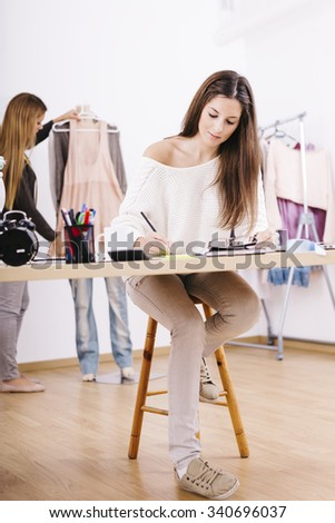 Young designer working on desk, team work - stock photo