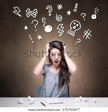 Young desperate girl writing an essay. Conceptual image.  - stock photo