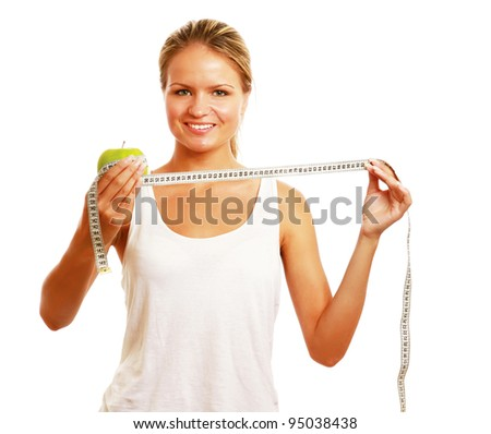 Young dietician pointing towards apple and measuring tape - stock photo