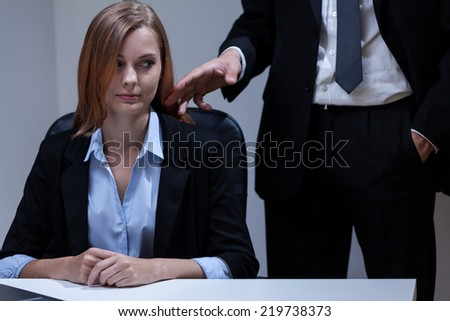 Young director of company flirting with his young attractive secretary - stock photo