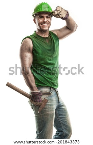 Young dirty Worker Man With Hard Hat helmet  holding a hammer and smiling isolated on White Background - stock photo