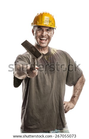Young dirty Worker Man With Hard Hat helmet  holding a hammer isolated on White Background - stock photo