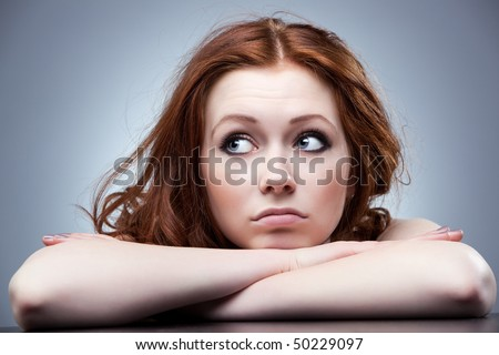 Young disappointed woman looking aside portrait. - stock photo