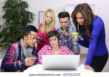 young diverse team of students or employees working - stock photo