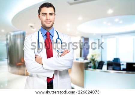 Young doctor at the hospital - stock photo