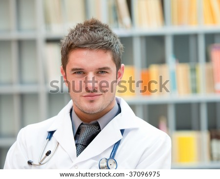 Young doctor at work in hospital - stock photo
