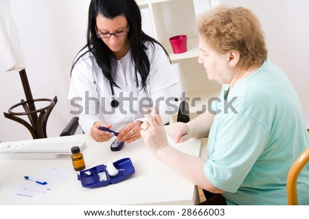 Young doctor check the blood-sugar level - stock photo