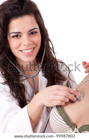 Young doctor examing a patient - stock photo