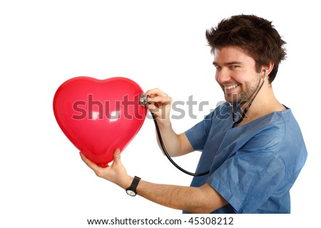 young doctor examining a heart shaped balloon - stock photo