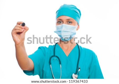 Young doctor is drawing, isolated on white background - stock photo
