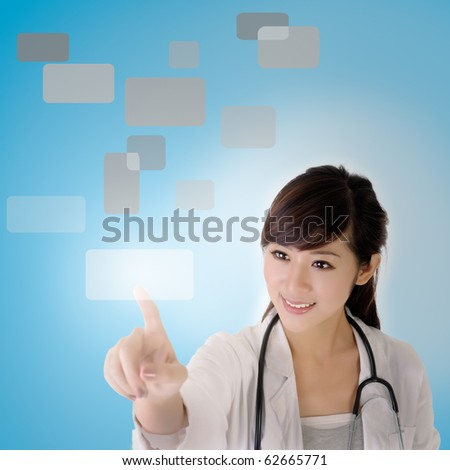 Young doctor press touchscreen with pleasure expression. - stock photo