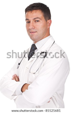 young doctor standing with his arms crossed and smiling - stock photo