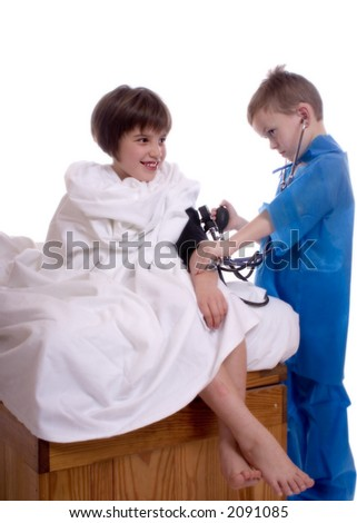 Young doctor taking the blood pressure of a patient.  Isolated against a white backdrop. - stock photo