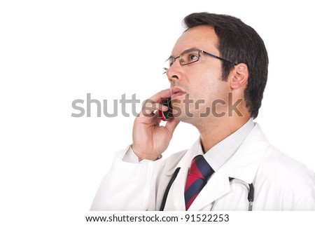 young doctor talking on the phone and looking worried - stock photo
