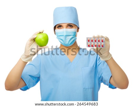 Young doctor with apple and pills isolated - stock photo