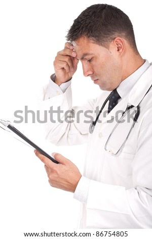 young doctor with his hand in his head and looking worried - stock photo