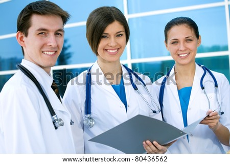 Young doctors confer outside the clinic - stock photo