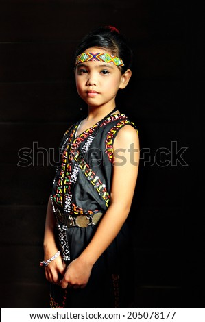 Young Dusun girl in traditional costume - stock photo