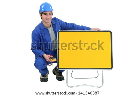 young electrician posing - stock photo