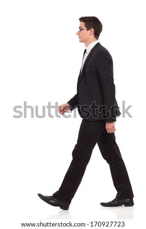 Young elegance man walking. Full length studio shot isolated on white. - stock photo