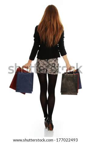 Young elegant blond woman with shopping bags, isolated on white background  - stock photo