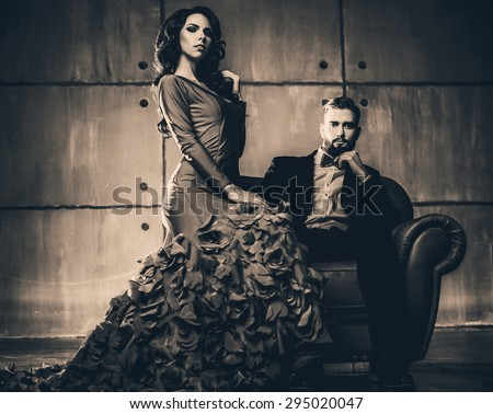 Young elegant couple in evening dress portrait. Retro film style colors. - stock photo