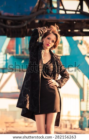 young elegant fashion woman pose in harbor - stock photo