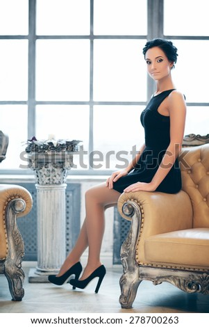 young elegant lady in luxury vintage interior, soft focus - stock photo