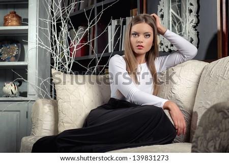Young elegant woman posing in luxury interior - stock photo