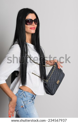 Young elegant woman with a handbag. A young woman of twenty-six years. - stock photo