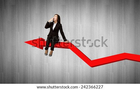 Young emotional businesswoman sitting on increasing graph - stock photo