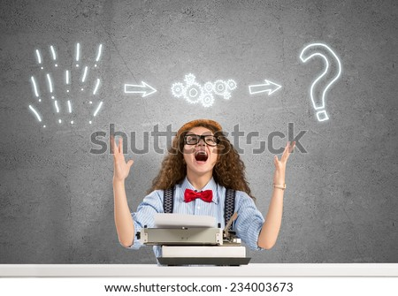 Young emotional girl writer using typing machine - stock photo