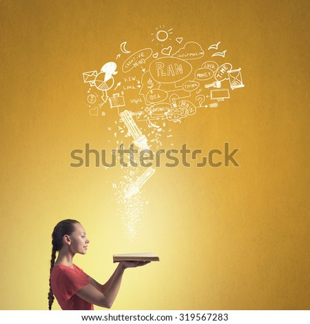 Young emotional woman in red dress with book in hand - stock photo