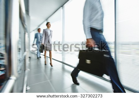 Young employees moving down office center - stock photo