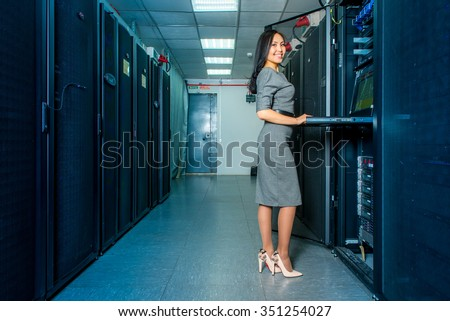 Young engineer businesswoman in network server room - stock photo