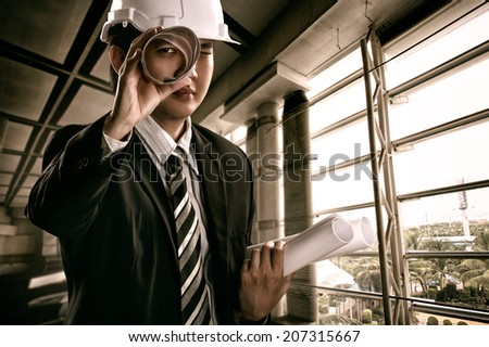 Young engineer hold the blueprints - stock photo