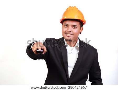 Young engineer portrait and remote - stock photo