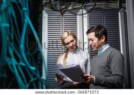 Young engineers businessmen in server room - stock photo