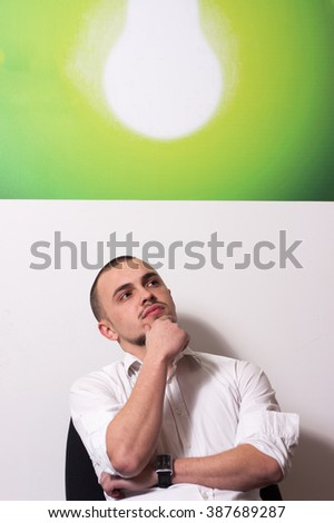 Young entrepreneur thinking about idea, idea concept - stock photo
