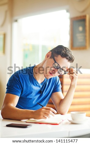 Young entrepreneur working in a cafe - stock photo