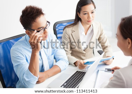 Young entrepreneurs hiring a financial adviser to develop the business - stock photo