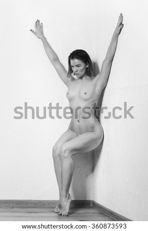 Young European fashion model woman with shiny healthy brunette hair, awesome gorgeous slim body and perfect skin, nude in studio for bodycare and wellness advertisement - stock photo