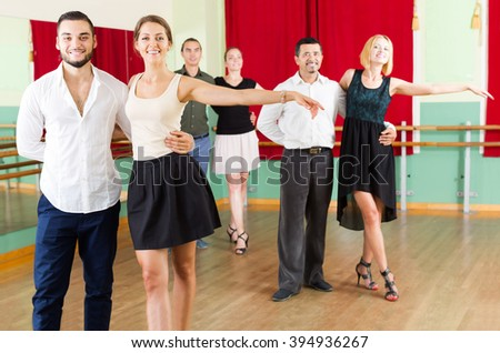 young european group of people have fun while dancing waltz - stock photo