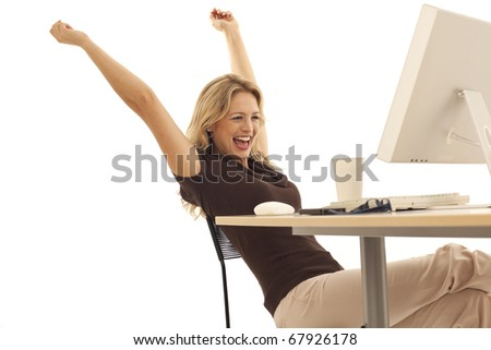 Young excited businesswoman at desk - stock photo