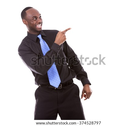 young excited casual black man  pointing hand on white background - stock photo