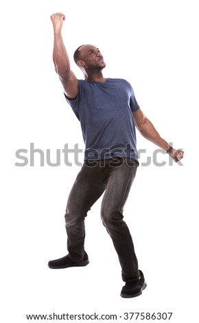young excited casual black man thrilled on white background - stock photo