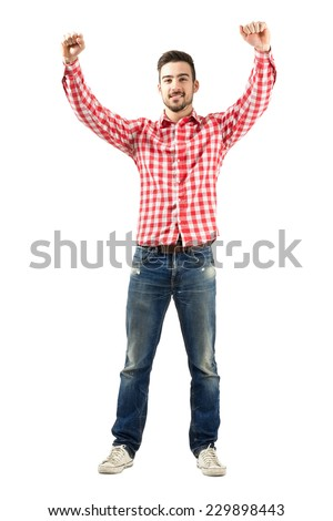 Young excited man with supportive encouraging raised hands. Full body length portrait isolated over white background. - stock photo