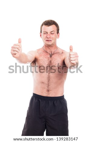 Young excited shirtless man showing thumbs up, isolated on white background - stock photo