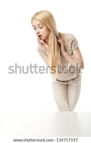 Young excited woman looking at the shop window isolated over white - stock photo